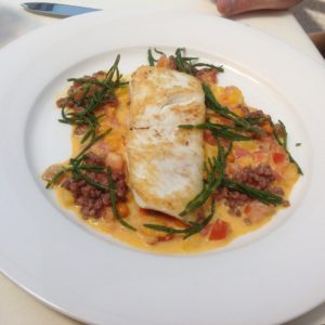 Halibut with sea buckthorn, tomato and sea beans.